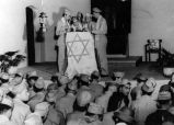 Reading the Torah at Rosh Hashanah service held for American soldiers during World War II, 1943...