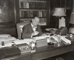 Photograph of former Nashville Mayor Ben West at his desk, August 1958