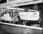 Photograph of storefront signs protesting Metro Consolidation, ca. 1962