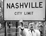 Photograph of Mayor Beverly Briley removing city limit sign, ca. 1962