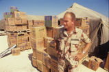 Troy Gibson, Tennessee National Guard, with boxes of water in Saudi Arabia, circa 1990 November 15