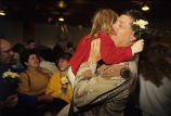Tennessee National Guardsman hugs girl carrying flower,  1991 March 15