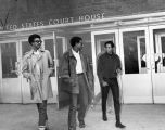 SNCC leaders H. Rap Brown, Stokely Carmichael, and George Ware leaving the U.S. Courthouse in...