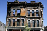Photograph of Goodies buildings, after the 1985 fire, front view showing upper stories.