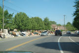 Street lined with debris from flooded homes in the River Plantation neighborhood after the May...
