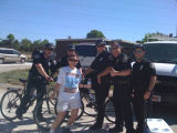 Lt. Matt Pylkas with fellow police officers and a volunteer in the River Plantation neighborhood...