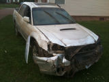 Lonnie Haynes's damaged car that flooded as he was driving to work during the May 2010 flood