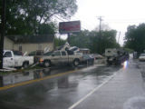Cars moved by floodwaters at the Antioch Pike and Blue Hole Road intersection during the May 2010...