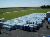 Staff and cases of bottled water distributed by the Office of Emergency Management during the May...