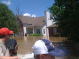 A man looks back at an inundated home in the Pennington Bend neighborhood during the May 2010 flood