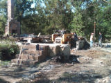 Contractors work to rebuild Lesli Bills's Pennington Bend home after a gas explosion destroyed...