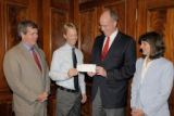 Sister Cities board members Doug Berry and Burkley Allen present a flood relief check, from...