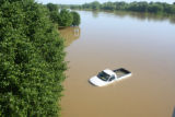 View of a pickup truck in the flooded Wyndham Resort parking lot during the May 2010 flood