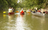 Volunteers gather debris during a river cleanup with the Harpeth River Watershed Association after...