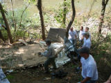 Volunteers gather the remaining pieces of a displaced shed during a Harpeth River Watershed...