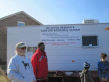 Michael Cain and volunteers stand by the Bellevue Rebuild and Restore Resource Center during a...