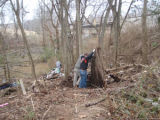 Volunteers clear debris during a Harpeth River Watershed Association cleanup after the May 2010...