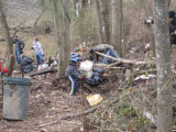 Volunteers gather trash in Bellevue during a Harpeth River Watershed Association cleanup after the...