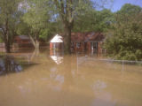 View of Lee and Amanda DeForest's inundated Madison home during the May 2010 flood