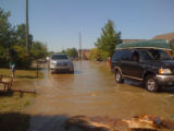 Cars drive through standing water in Pennington Bend during the May 2010 flood