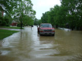 A truck drives through standing water during the May 2010 flood in Bellevue