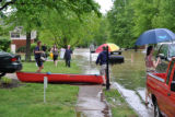 People carry possessions from their homes in Bellevue during the May 2010 flood