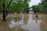 Water engulfs a Bellevue neighborhood block during the May 2010 flood