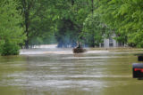A rescue boat travels through a flooded neighborhood in Bellevue during the May 2010 flood