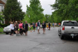 Bellevue residents gather together in the street as water covers the rest of the neighborhood...