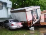 Car sandwiched between mobile homes during the May 2010 flood in Antioch