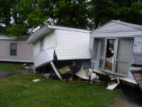 Contents spill out of a ruptured mobile home during the May 2010 flood in Antioch