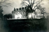 Oblique right frontal elevation with lights on porch of the Bonnie Brae residence, Nashville,...