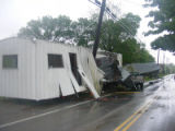 Office trailer collides with telephone pole along Antioch Pike during the May 2010 flood