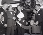 Liberace arrives at Nashville airport, 1950s