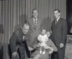 Andrew Benedict with grandchild and parents in Mayor West's office, 1962 November 18