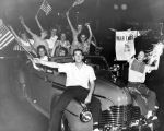 Photograph of youths celebrating the end of WW II in the Pacific in Nashville, Tennessee, 1945...