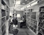Photograph of the interior of the Nashville Public Library bookmobile, circa 1957