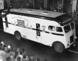 Photograph of the Nashville Public Library bookmobile in the Nashville Christmas parade, 1955