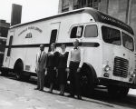 Photograph of staff members in front of a Nashville Public Library bookmobile, circa 1955