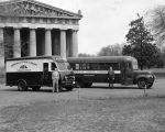 Photograph of two Nashville Public Library bookmobiles in Centennial Park in front of the...