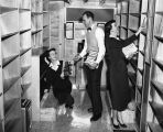 Photograph of Nashville Public Library staff members shelving books in the bookmobile, circa 1955