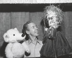 Photograph of puppeteer Tom Tichenor with puppets Witchie and Marco Polo Bear, 1962