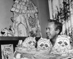Photograph of puppeteer Tom Tichenor and a Nashville Public Library's Children's Division display,...