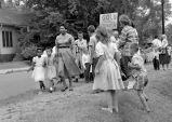 Photograph of Grace McKinley walking her daughter, Linda Gail McKinley to Fehr Elementary School,...