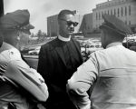 Photograph of Reverend Joseph Metz Rollins and police officers, 1963 May 09