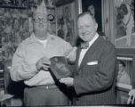 Colonel Tom Parker presented with an honorary plaque by Mayor Ben West, 1960 November 16
