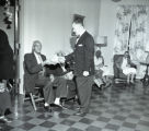 Mayor Ben West and son Jay visit residents at the Knowles Home, 1961 December 23