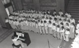 School music choral group performing in the lobby of the Nashville Courthouse building, Nashville,...