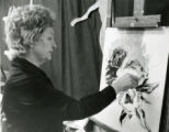 Artist painting on canvas board at the Tennessee State Fair, Nashville, Tennessee, 1975 September